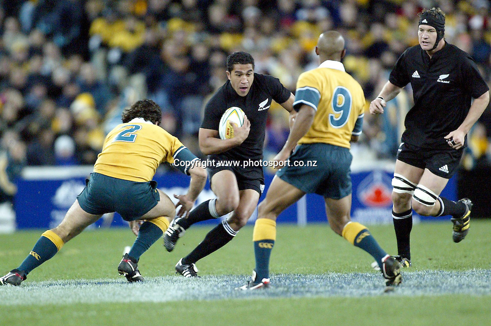 Mils Muliaina in action during the Bledisloe Cup international rugby match between the New Zealand All Blacks and Australia at Telstra Stadium, Sydney, Australia on 26 July, 2003. The All Blacks won the match, 50 -21. Photo: Andrew Cornaga/PHOTOSPORT<br /><br /><br /><br />260703