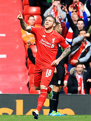 Alberto Moreno of Liverpool celebrates after scoring his sides first goal - Mandatory by-line: Matt McNulty/JMP - 10/04/2016 - FOOTBALL - Anfield - Liverpool, England - Liverpool v Stoke City - Barclays Premier League