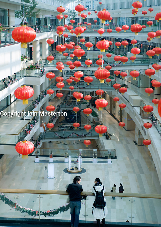 Interior of large new modern luxury shopping mall in central Beijing China 2009