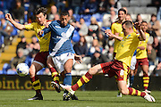 Burnley midfielder Dean Marney and Burnley midfielder Joey Barton tackles Birmingham City midfielder David Davis during the Sky Bet Championship match between Birmingham City and Burnley at St Andrews, Birmingham, England on 16 April 2016. Photo by Alan Franklin.