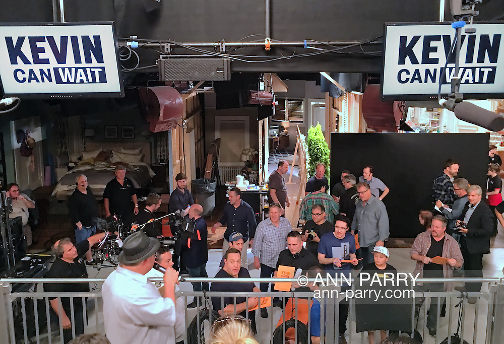 """Bethpage, New York, USA. August 19, 2016. Actor KEVIN JAMES (middle of low railing) the star of the CBS new comedy series """"Kevin Can Wait"""" set to premiere mid September 2016, autographs copies of the script cover of the first episode, right after filming is completed. After the pilot was shot,13 episodes were ordered in May. The Sony Pictures Television Inc show is the first series to be shot entirely on Long Island, and is filmed at Gold Coast Studioes. Kevin James, a Long Island native, portrays the title character Kevin Gable, a newly retired police officer who lives with his family in Massapequa. Other cast members, several who also autographed the cover, include: Erinn Hayes as his wife Donna, a school nurse; Taylor Spreitler as their older daughter Kendra; Ryan Cartwright as Kendra's fiance; Mary-Charles Jones as the younger daughter Sara; and JAMES DIGIACOMO as the young son Jack, and GARY VALENTINE as Kevin's brother Kyle Gable. Episode #101 was written by Heather Flanders and Directed by Andy Fickman. Executive Producers are Mr. James, Bruce Helford, Rock Reuben, and Jess Sussman."""