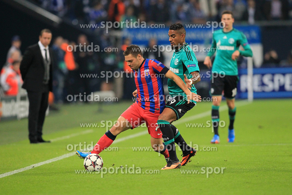 18.09.2013, Veltins Arena, Gelsenkirchen, GER, UEFA Champions League, Schalke 04 vs Steaua Bukarest, Gruppe E, im Bild Kevin-Prince Boateng #9 (FC Schalke 04) im Zweikampf gegen Adrian Popa #77 (Steaua Bukarest), Aktion, Action, //  during UEFA Champions League group E match between Schalke 04 vs Steaua Bukarest at the Veltlins Arena, Gelsenkirchen, Germany on 2013/09/18. EXPA Pictures &copy; 2013, PhotoCredit: EXPA/ Eibner/ Joerg Schueler<br /> <br /> ***** ATTENTION - OUT OF GER *****