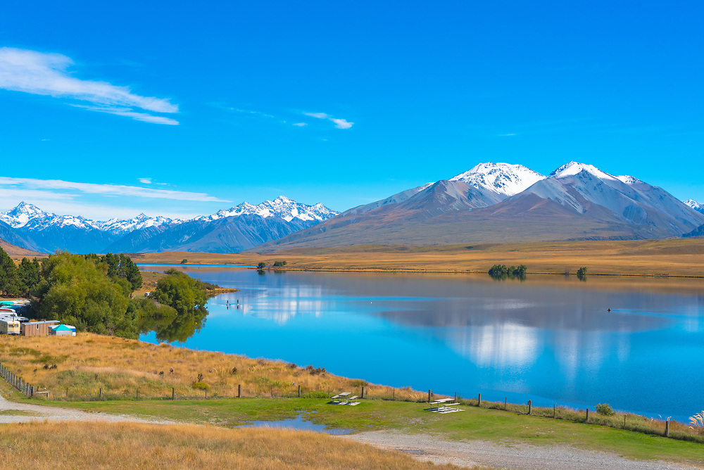 Clearwter lake in New Zealand with snow capped mountains in the background
