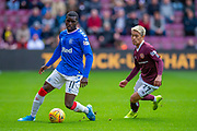 Sheyi Ojo (#11) of Rangers FC turns away from Ryotaro Meshino (#77) of Heart of Midlothian FC during the Ladbrokes Scottish Premiership match between Heart of Midlothian and Rangers FC at Tynecastle Park, Edinburgh, Scotland on 20 October 2019.