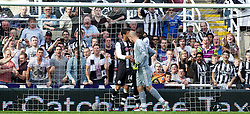 NEWCASTLE-UPON-TYNE, ENGLAND - Sunday, April 1, 2012: Liverpool's goalkeeper Jose Reina leans his head into Newcastle United's James Perch which leads to his sending off during the Premiership match at St James' Park. (Pic by Vegard Grott/Propaganda)