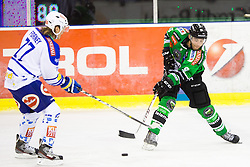 20.10.2013, Hala Tivoli, Ljubljana, SLO, EBEL, HDD Telemach Olimpija Ljubljana vs EC VSV, 25th Game Day, in picture Judd Blackwater (HDD Telemach Olimpija, #9) vs Michael Forney (EC VSV, #77) during the Erste Bank Icehockey League 25th Game Day match between HDD Telemach Olimpija Ljubljana and EC VSV at the Hala Tivoli, Ljubljana, Slovenia on 2013/10/20. (Photo By Matic Klansek Velej / Sportida)