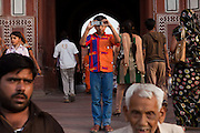A boy is taking a picture of the Taj Mahal with his phone as soon as he entered from the Great Gate, in Agra.