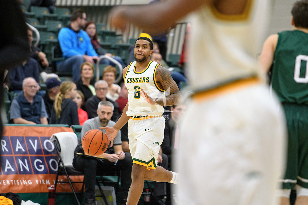 5th year guard Matthew Augustine (6) of the Regina Cougars in action during the home game on December  2 at Centre for Kinesiology, Health and Sport. Credit: Arthur Ward/Arthur Images
