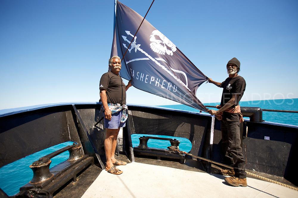 Ron Roe (L) and Richard Hunter (R), Goolarabooloo native people, holding the SeaShepherds flag on Seashepherd's Vessel 'Steve Irwin' during Operation Kimberley Miinimbi. Broome, WA
