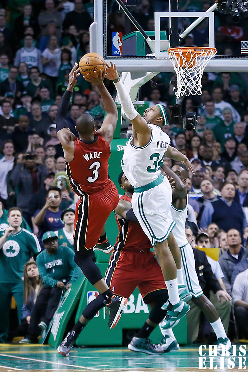 18 March 2013: Miami Heat shooting guard Dwyane Wade (3) takes a jumpshot over Boston Celtics small forward Paul Pierce (34) during the Miami Heat 105-103 victory over the Boston Celtics at the TD Garden, Boston, Massachusetts, USA.