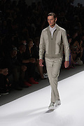 A men's outfit with sage-green trousers and coordinated two-toned jacket by Richard Chai at the Spring 2013 Mercedes Benz Fashion Week show in New York.