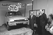 Renault 5, Launch in Dublin  (G20)..1974..25.01.1974..01.25.1974..25th January 1974..At the Burlington Hotel ,Dublin, Renault Ireland unveiled their newest addition to the fleet of cars in the Renault range. The Renault 5 will fill a niche in the small car market and is competitively priced at £1495. .Picture shows (L-R),Mr Patrick Kilroy, Chairman,Smith Motor Group, Mr Georges Graf,Commercial Attache,French Embassy,Dublin and  Mr Tom Lynch,Main Dealer,Renault,Cork admiring the newly unveiled Renault 5.