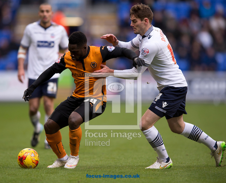 Nouha Dicko of Wolverhampton Wanderers (left) is closed down by Dorian Dervite of Bolton Wanderers during the Sky Bet Championship match at the Macron Stadium, Bolton<br /> Picture by Russell Hart/Focus Images Ltd 07791 688 420<br /> 31/01/2015