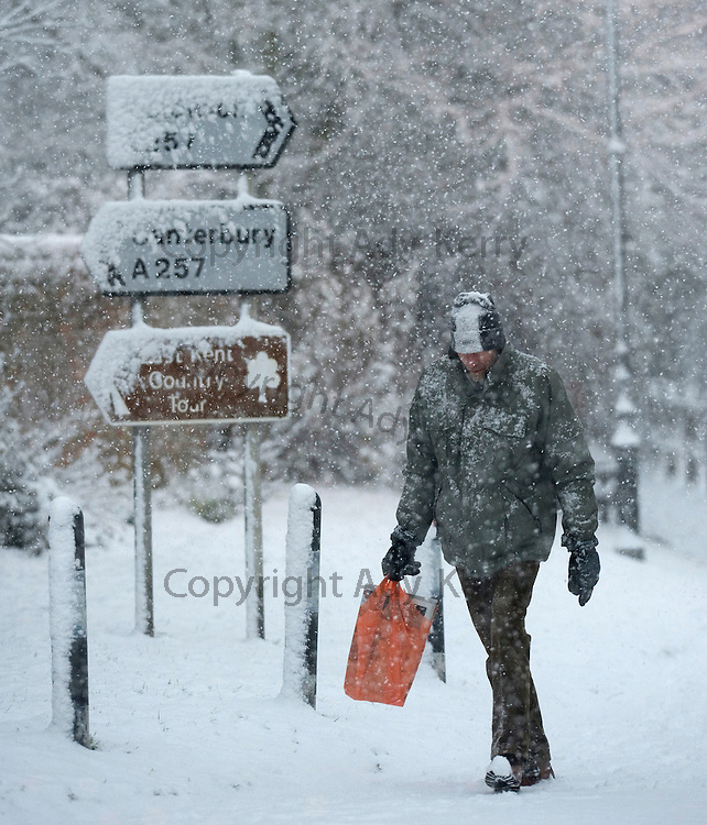 A man walks through the kent village of Wingham as the snow falls and brings chaos to the country, 18th December 2010..