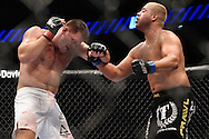 "LONDON, ENGLAND, JUNE 7, 2008: Antoni Hardonk (left) and Eddie Sanchez trade blows during ""UFC 85: Bedlam"" inside the O2 Arena in Greenwich, London on June 7, 2008."