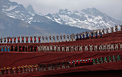 Performers of various ethnic minority of the Naxi, Yi and Bai people performs in large scale culture show Impression Lijiang against the backdrop of the Jade Dragon Snow Mountain in Lijiang, Yunnan Province, China, 05 April 2012. Demonstrating the traditions and lifestyles of the Naxi, Yi and Bai peoples of the area, the large scale production is designed by famous Chinese director Zhang Yimou. The show takes place inside Jade Dragon Snow Mountain Park at an altitude of 3500m in an outdoor theater specifically designed to showcase the mountain which is used as a backdrop.