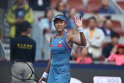 BEIJING, Oct. 3, 2018  Zhang Shuai of China waves to spectators after winning the women's singles second round match against Timea Babos of Hungary at China Open tennis tournament in Beijing, China, Oct. 3, 2018. Zhang Shuai won 2-0. (Credit Image: © Song Yanhua/Xinhua via ZUMA Wire)