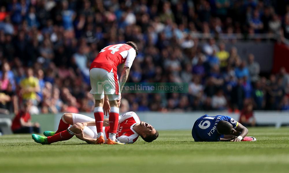 21 May 2017 London : Premier League - Arsenal v Everton :<br /> Arsenal defender Gabriel injures himself as he tackles Enner Valencia.<br /> Photo: Mark Leech