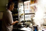 the proprietor of a Kuching kopi tiam (coffee shop) making noodles