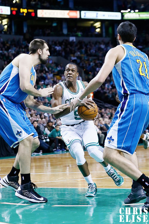 16 January 2013: Boston Celtics point guard Rajon Rondo (9) drives to the basket past New Orleans Hornets power forward Ryan Anderson (33) during the New Orleans Hornets 90-78 victory over the Boston Celtics at the TD Garden, Boston, Massachusetts, USA.