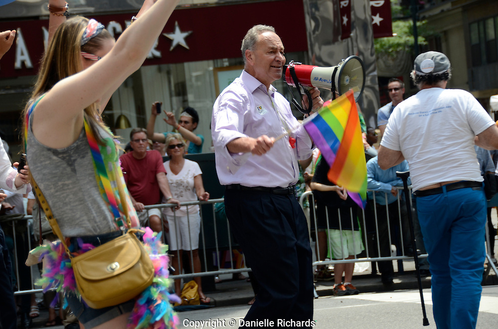 Sen. Charles Schumer of NY marching the annual Pride Parade in New York City. Gay rights supporters had much to celebrate at this year's New York City Pride Parade, which came on the heels of the Supreme Court's decision to overturn DOMA (Defense of Marriage Act).  The ruling extends federal benefits to same-sex couples who are married in states that recognize gay marriage.