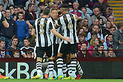 Newcastle players celebrate the own goal by Aston Villa defender Tommy Elphick (6) 0-1 during the EFL Sky Bet Championship match between Aston Villa and Newcastle United at Villa Park, Birmingham, England on 24 September 2016. Photo by Alan Franklin.
