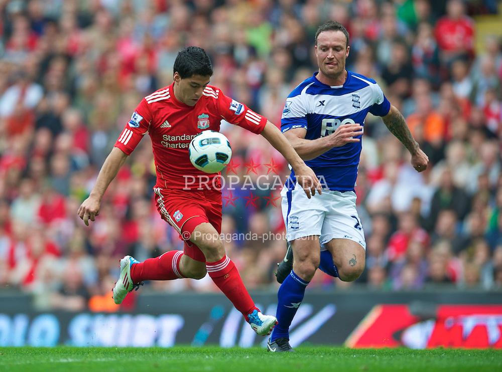 LIVERPOOL, ENGLAND - Saturday, April 23, 2011: Liverpool's Luis Alberto Suarez Diaz and Birmingham City's Martin Jiranek during the Premiership match at Anfield. (Photo by David Rawcliffe/Propaganda)