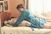 Girl on bed, London, UK, 1981