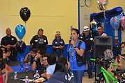 Bikes for Excellence founder Martha Jaimes speaks to students.