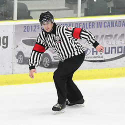 COBOURG, - Mar 9, 2016 -  Ontario Junior Hockey League game action between Kingston Voyageurs and Cobourg Cougars. Game 4 of the first round playoff series. At the Cobourg Community Centre, ON. OHA Referee during the second period.(Photo by Tim Bates / OJHL Images)