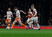 Football - 2018 / 2019 EFL Carabao (League) Cup - Fourth Round: Arsenal vs. Blackpool<br /> <br /> <br /> Oliver Turton (Blackpool FC) passes back under pressure from Emile Smith Rowe (Arsenal FC) at The Emirates.<br /> <br /> COLORSPORT/DANIEL BEARHAM
