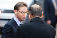 Jyrki Katainen, Prime minister of Finland (left) talks to Janez Jansa, Prime minister of Slovenia, waiting for a car leaving the  EU Budget summit at the European Council building for a break in Brussels, Friday, Feb. 8, 2013. A European Union summit to decide EU spending for the next seven years entered a second day after all-night negotiations left a standoff over spending unresolved. The leaders of the 27 nations inched toward a compromise Friday that would leave their common budget with a real-term cut for the first time in the EU's history.