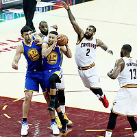09 June 2017: Golden State Warriors guard Stephen Curry (30) drives past Cleveland Cavaliers guard Kyrie Irving (2) and Cleveland Cavaliers forward LeBron James (23) during the Cleveland Cavaliers 137-11 victory over the Golden State Warriors, in game 4 of the 2017 NBA Finals, at  the Quicken Loans Arena, Cleveland, Ohio, USA.