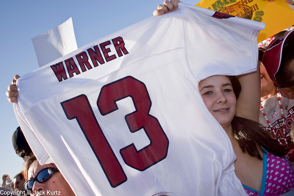 Feb 2, 2009 -- PHOENIX, AZ: A girl holds up a Kurt Warner jersey to greet the returning Arizona Cardinals in Phoenix. More than 4,000 people came to Sky Harbor Airport in Phoenix to welcome home the Arizona Cardinals, the city's NFL team. The Cardinals lost the Superbowl to the Pittsburgh Steelers 27 - 23.   Photo By Jack Kurtz / ZUMA Press