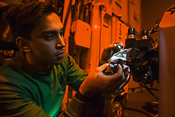 "180924-N-MK318-0053<br /> NORTH ATLANTIC (Sept. 24, 2018) Aviation Electronics Technician 3rd Class Alejandro Vargas, assigned to the ""Proud Warriors"" of Helicopter Maritime Strike Squadron (HSM) 72, changes oil on helicopter equipment in the hangar bay aboard the Nimitz-class aircraft carrier USS Harry S. Truman (CVN 75). Currently operating in the U.S. 6th Fleet area of operations, Harry S. Truman will continue to foster cooperation with regional allies and partners, strengthen regional stability, and remain vigilant, agile and dynamic. (U.S. Navy photo by Mass Communication Specialist 3rd Class Victoria Granado/Released)"