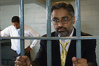 Two men behind bars