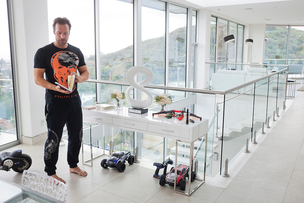 Bastian Yotta and his wife Maria Yotta live what they call the &quot;Yotta Life&quot; in LA. Here, Bastian standing next to kind of an altar with &quot;hate&quot; on the right side and &quot;love&quot; on the left. In his home in Hollywood Hills, close to Hollywood Reservoir. Los Angeles California, USA.<br /> <br /> Photo by Knut Egil Wang/VG/MOMENT/INSTITUTE