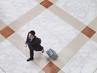Business man walking with suitcase elevated view