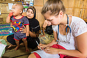 22 MAY 2013 - MAELA, TAK, THAILAND:   Dr. MARGAREET TRIP, a Dutch pediatrician, talks to a Burmese Muslim woman about her child in the SMRU Clinic in the Maela Refugee Camp. Health professionals are seeing increasing evidence of malaria resistant to artemisinin coming out of the jungles of Southeast Asia. Artemisinin has been the first choice for battling malaria in Southeast Asia for 20 years. In recent years though,  health care workers in Cambodia and Myanmar (Burma) are seeing signs that the malaria parasite is becoming resistant to artemisinin. Scientists who study malaria are concerned that history could repeat itself because chloroquine, an effective malaria treatment until the 1990s, first lost its effectiveness in Cambodia and Burma before spreading to Africa, which led to a spike in deaths there. Doctors at the Shaklo Malaria Research Unit (SMRU), which studies malaria along the Thai Burma border, are worried that artemisinin resistance is growing at a rapid pace. Dr. Aung Pyae Phyo, a Burmese physician at a SMRU clinic just a few meters from the Burmese border, said that in 2009, 90 percent of patients were cured with artemisinin, but in 2010, it dropped to about 70 percent and is now between 55 and 60 percent. He said the concern is that as it becomes more difficult to clear the malaria parasite from a patient, progress that has made been in combating malaria will be lost and the disease could make a comeback in Southeast Asia.     PHOTO BY JACK KURTZ