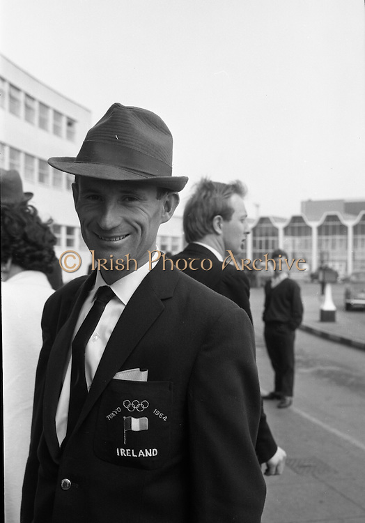 Members of the Irish Olympic team leaves for Amsterdam on the first stage of their journey to Tokyo.  Picture shows J. Hogan, 10,000 metres..04.10.1964
