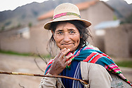 Potolo, Bolivia  -  Nov 5, 2015 - A Jalq'a sheep herder pauses for a moment while bringing her flock in from their pasture.  CREDIT: Michael Benanav for The New York Times