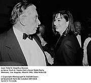 Gore Vidal & Angelica Huston at Steve Tisch &  Vanity Fair's Oscar Night Party,<br />Mortons,  Los Angeles. March 1994.  Film 94563/20<br /> <br />© Copyright Photograph by Dafydd Jones<br />66 Stockwell Park Rd. London SW9 0DA<br />Tel 0171 733 0108.