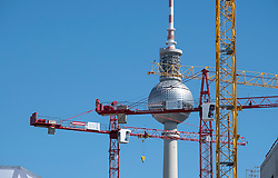 Berlin Television Tower or Fernsehturm and many construction cranes in Mitte Berlin Germany