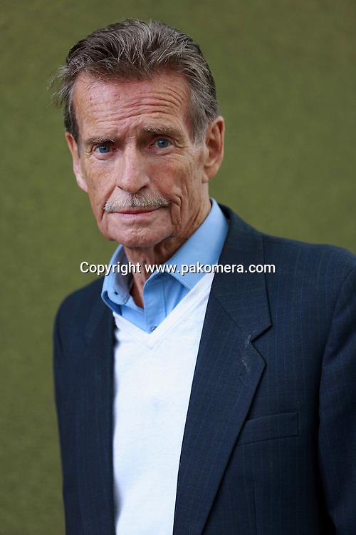 William McIlvanney photographed in Charlotte Square Gardens during Edinburgh International Book Festival 2014.