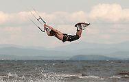 A man rides a kiteboard in the surf on Lake Champlain at Ausable State Park in Peru, NY on Monday, August 24, 2015.   © Chet Gordon • Photographer