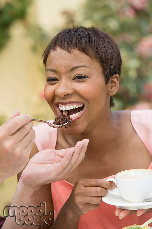 Woman sharing dessert outdoors