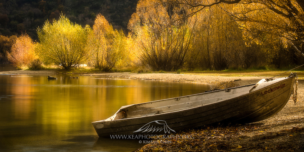 A peaceful reflection of fall foliage at Lake  Hayes, Central Otago, New Zealand.