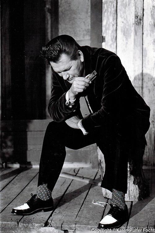 Billy Lee Riley was a Sun Record artist with a few hits in the late 50's. He started recording again later in his life, he he is shown with his harmonica in the early 90's in Memphis,Tennessee.
