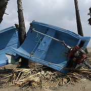 A broken fishing boat litters the beach of Perumalpettai, a fishing village in Tamil Nadu, India, on January 15, 2005, after the area was struck by the Indian Ocean Tsunami on December 26, 2004, killing 37 of the villagers and destroying nearly all of their fishing boats. Generated by an earthquake on the ocean floor, the tsunami devastated the fishing industry along the southeastern coast of India.