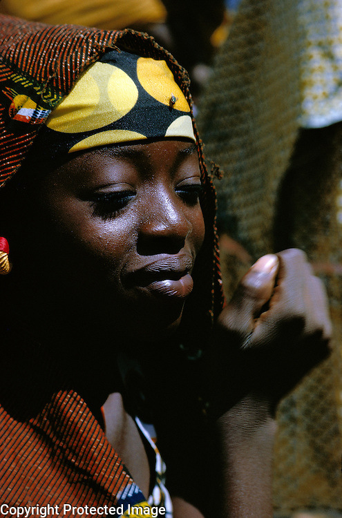 Portrait of woman at market in Bobo Dioulasso, Burkina Faso, Africa.